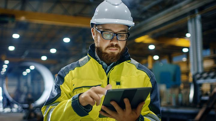 workman holding tablet